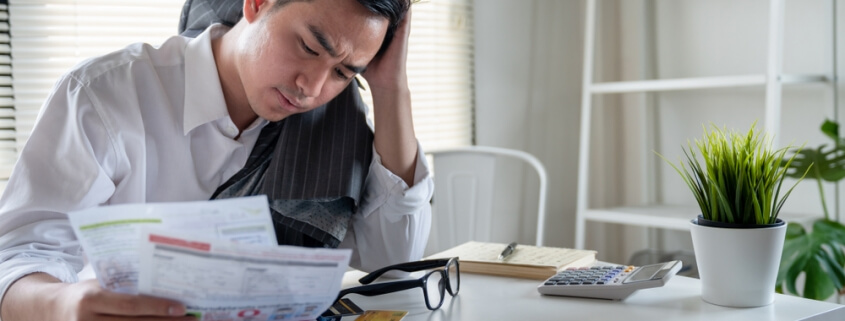 stressed man with debt